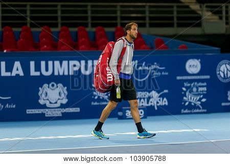 KUALA LUMPUR, MALAYSIA - SEPTEMBER 26, 2015: Luca Vanni of Italy enters the court his qualifying match in the Malaysian Open 2015 Tennis tournament held at the Putra Stadium, Malaysia.