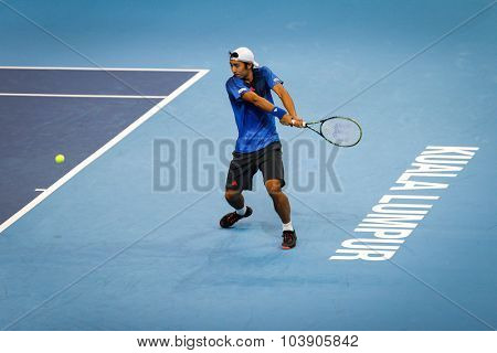 KUALA LUMPUR, MALAYSIA - SEPTEMBER 26, 2015: Yasutaka Uchiyama of Japan plays in his qualifying match in the Malaysian Open 2015 Tennis tournament held at the Putra Stadium, Malaysia.