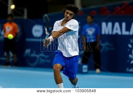 KUALA LUMPUR, MALAYSIA - SEPTEMBER 26, 2015: Syed Mohd Agil of Malaysia plays in his qualifying match in the Malaysian Open 2015 Tennis tournament held at the Putra Stadium, Malaysia.