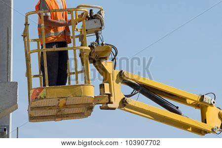 Worker In Lifting Platform