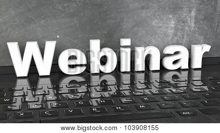 Webinar 3D text on laptop keyboard, with blackboard on screen.