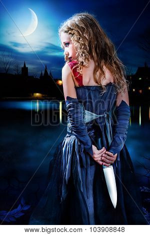 Terror Girl Holding Knife At Moonlit Lake.