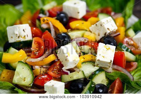 Fresh Close Up Vegetable Greek Salad With Feta Cheese, Black Olives, Cherry Tomatoes, Yellow Pepper,