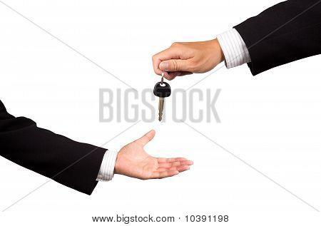 receiving car key from salesman