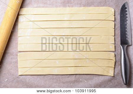 Cut Into Strips Of Dough On Baking Paper