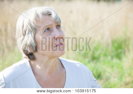 Old age woman looking up