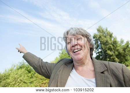 Old age woman pointing with finger