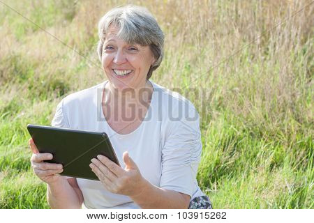 Senior woman using tablet device