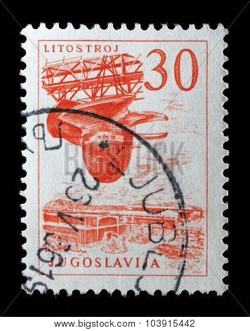YUGOSLAVIA - CIRCA 1958: A Stamp printed in the Yugoslavia shows Litostroj turbine factory, circa 1958