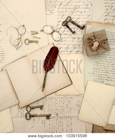 Vintage accessories open book old letters and documents. Sentimental nostalgic background. Retro style toned picture