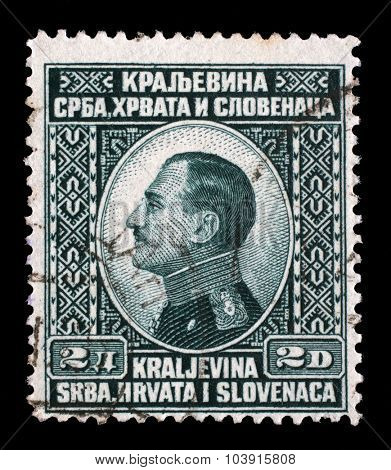 YUGOSLAVIA - CIRCA 1924: A stamp printed in Yugoslavia (Kingdom Serbia, Croatia and Slovenia) shows portrait of King Alexander I of Yugoslavia, series King Alexander I, circa 1924