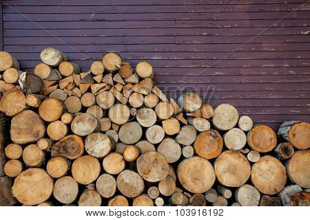 Background of wood logs and old wall, with copy space for text