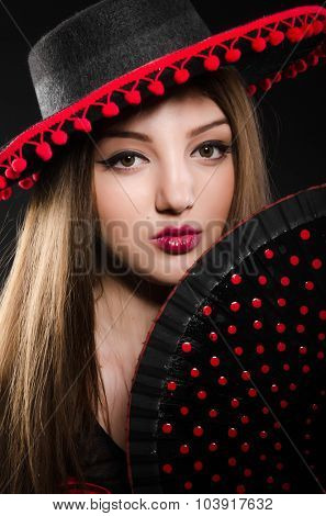 Woman with fan in fashion concept