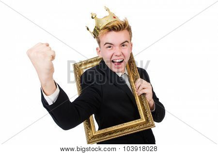 Young businessman with crown and picture frame isolated on white