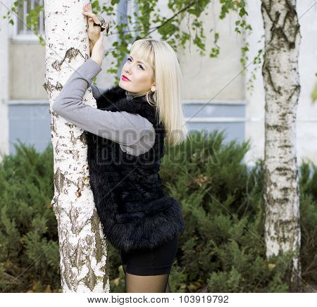 The Beautiful Woman In A Fur Coat Leaned Against A Birch, Fall
