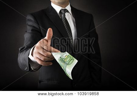 Businessman Giving Euro