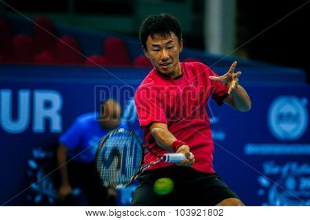 KUALA LUMPUR, MALAYSIA - SEPTEMBER 27, 2015: Takao Suzuki of Japan plays a return in his qualifying match at the Malaysian Open 2015 Tennis tournament held at the Putra Stadium, Malaysia.