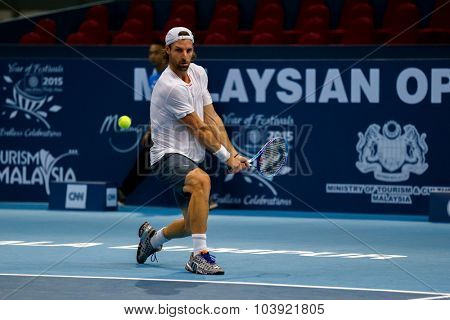 KUALA LUMPUR, MALAYSIA - SEPTEMBER 27, 2015: Andre Begemann of Germany plays in his qualifying match at the Malaysian Open 2015 Tennis tournament held at the Putra Stadium, Malaysia.