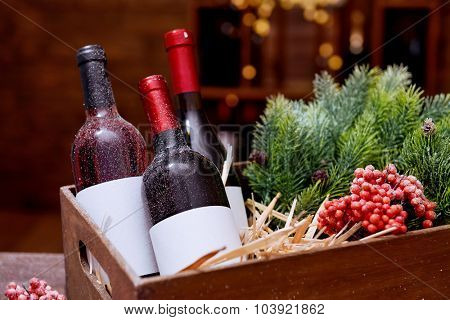 Wine bottles in decorated box on unfocused background