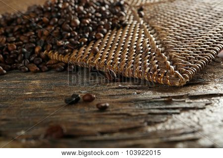 roasted coffee scattered on wooden background