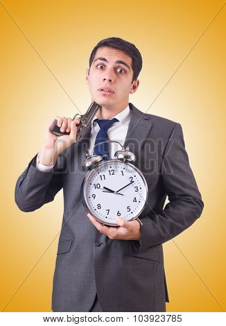 Man with gun and clock on white
