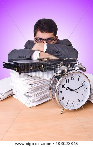 Businessman with giant alarm clock