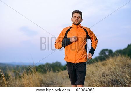 Young Man Running Outdoor on the Trail in the Park. Active Lifestyle Concept