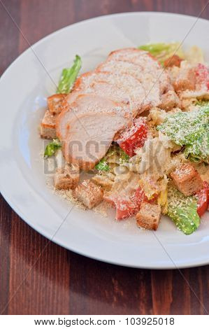 Chicken ceasar salad closeup photo