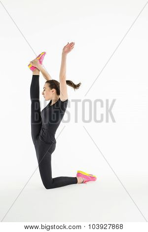 Sportswoman doing difficult exercise for stretching