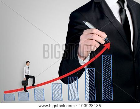 Business man close-up write success chart