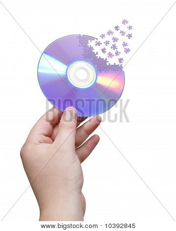 Cd in hand cut jigsaw puzzle over white