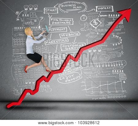 Business woman climb red arrow with laptop in hand