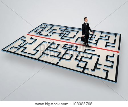 Maze and business man walk to exit