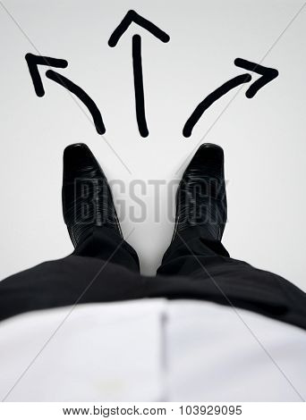Business man shoes close-up choosing direction