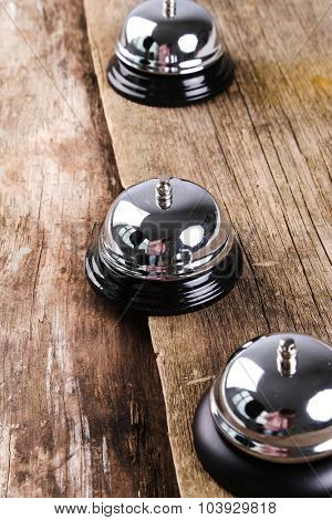 Ring bell on the wooden table
