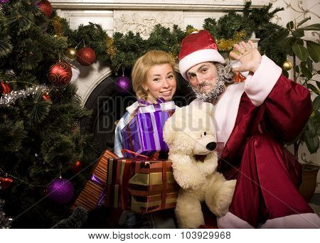 portrait of funny Santa Claus at home with christmass tree, real normal man