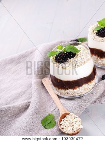 Healthy food. Delicious muesli dessert with blackberry