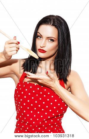 Sexy Housewife Cook In Red Dotted Apron Holding Kitchen Spoon