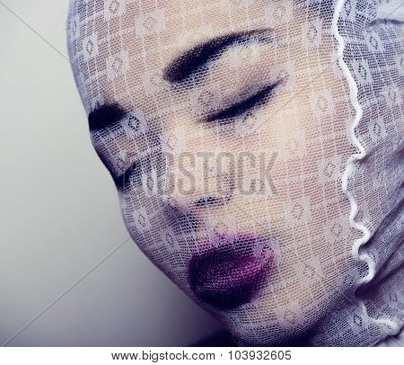 fashion robber with pantyhose on head, glamorous mask for halloween close up