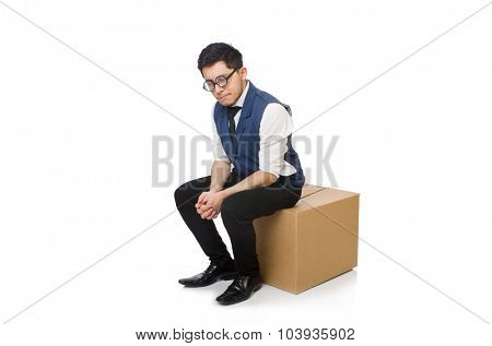 Young employee sitting on the box isolated on white
