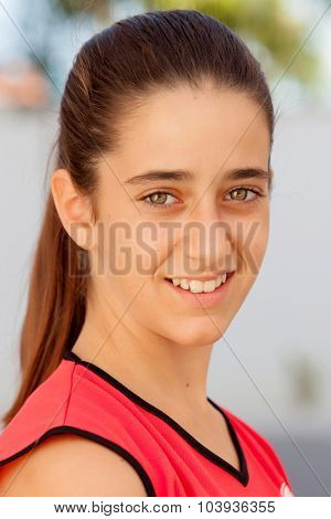Nice twelve years old girl with brown eyes outdoor
