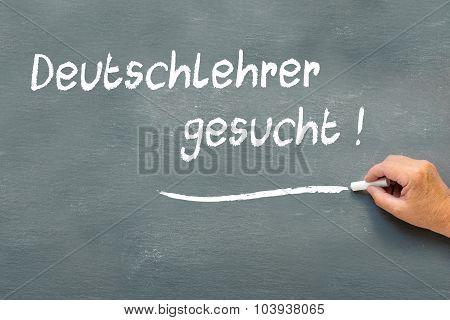 Hand Writing On A Chalkboard In German Deutschlehrer Gesucht