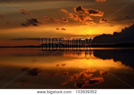 Fiery Sunset Mirror. Lake Pongoma, North Karelia, Russia