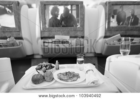 DUBAI - JUNE 23, 2015: Emirates Boeing 777 business class interior. Emirates handles major part of passenger traffic and aircraft movements at the airport.