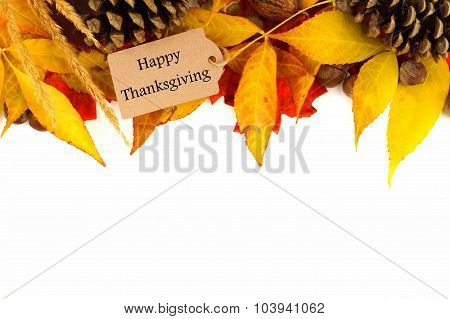 Happy Thanksgiving gift tag with colorful leaves border over white