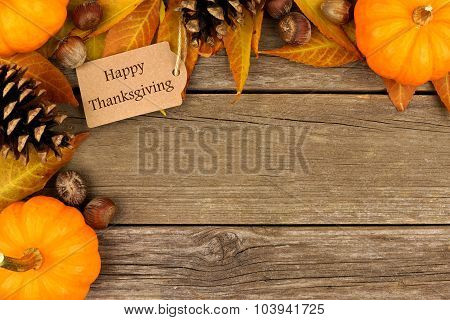 Happy Thanksgiving gift tag with autumn corner border over wood