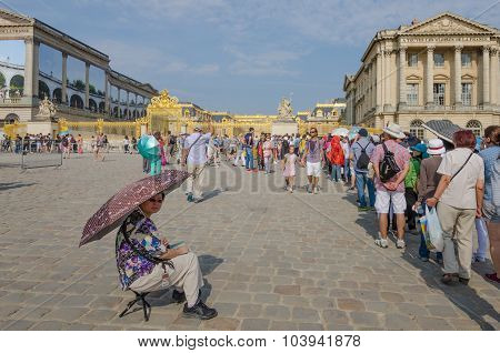 Senior woman in line-up for the Palace of Versailles