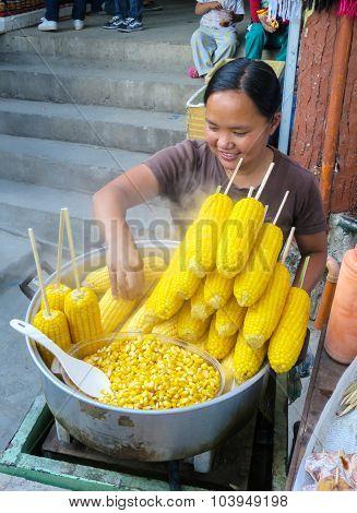 Street Vendor Selling Steamed Corn