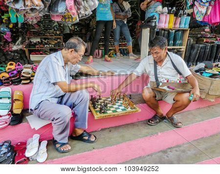 Men Play Sidewalk Chess
