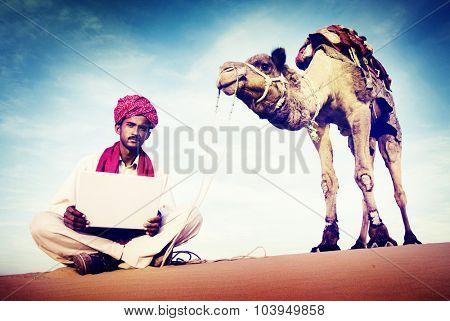 Indian Man Using Laptop Desert Concept